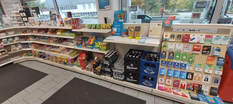 Getränke und Knabbereien in Tankstelle Total Access in Bad Fallingbostel